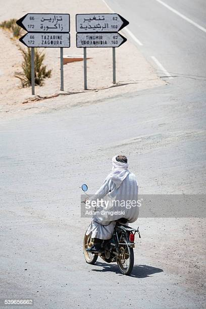 Morrocan man riding on a motorcycle