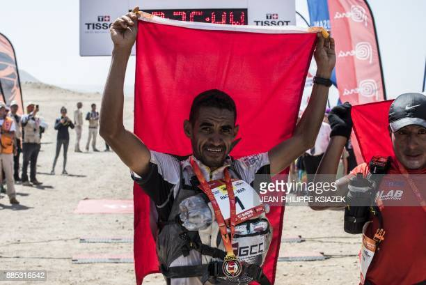 Morrocan trail runner Rachid El Morabity crosses the finish line to win the first edition of the Marathon des Sables Peru in Paracas on December 4 in...