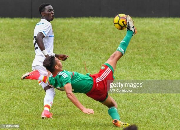 Morroco's Achraf Dari kicks the ball despite Congo's Chadrack Lukombe during the semifinal football match between Morroco and the Democratic Republic...