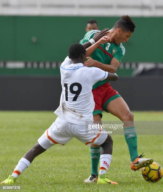 Morroco's Achraf Dari vies with Congo's Glody Likonza during the semifinal football match between Morroco and the Democratic Republic of Congo at...