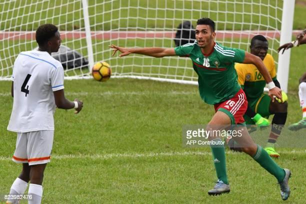 Morroco's Hamza Hannouri celebrates scoring in the semifinal football match between Morroco and the Democratic Republic of Congo at the Felix...