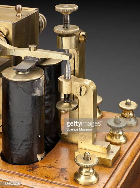 Morse embosser 1853 Front 3/4 view of whole object against graduated grey background