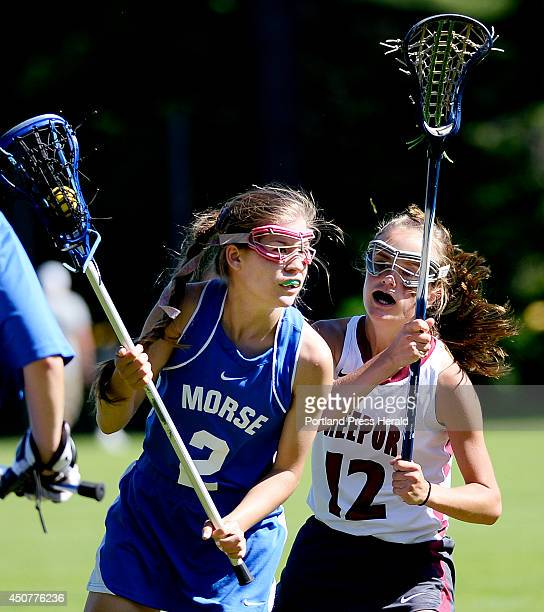 Morse's Ruth Nadeau drives with the ball as Freeport's Emily Johnson plays tight defense in girls lacrosse action Monday June 16 2014
