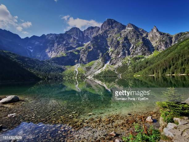 morskie oko has a view. summer in the tatras, holidays in the mountains. - poland stock pictures, royalty-free photos & images