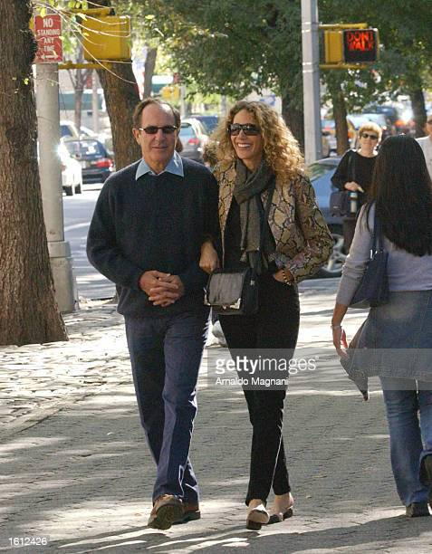 Mort Zuckerman owner of the New York Daily News walks along Central Park with Marisa Berenson after having lunch at LaGoulue Restaurant on Madison...
