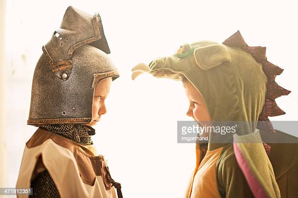 mortal enemies - knight and dragon. - period costume stock pictures, royalty-free photos & images