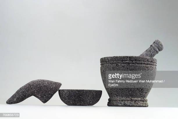 Mortar And Pestle Against White Background