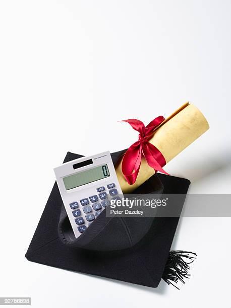 Mortar board and scroll on calculator.