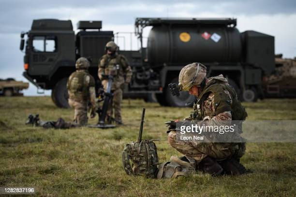 Mortar platoon from the Royal Anglian Regiment bed in after establishing a Leaguer during their Mission Rehearsal Exercise ahead of deployment to...