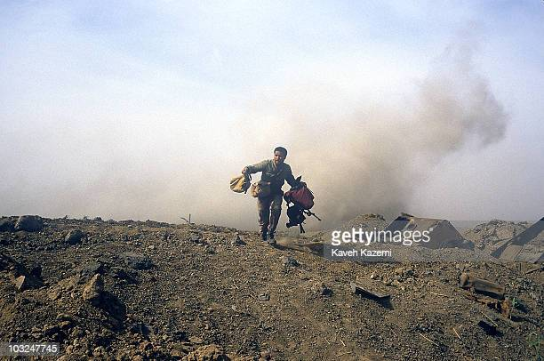 Mortar shell explodes behind an Iranian Revolutionary Guard who was helping members of the press with their equipment in Al-Fao Peninsula, Iraq, 15th...
