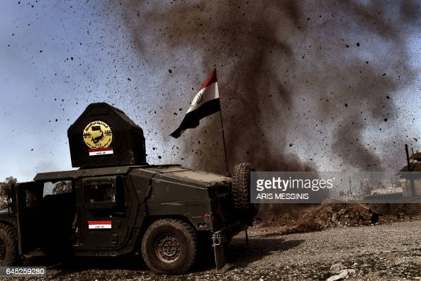 Mortar thrown by Islamic State group fighters lands near a vehicle belonging to Iraq's elite Rapid Response Division during the assault to retake the...