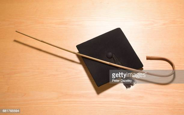mortarboard and cane corporal punishment - corporal punishment stock pictures, royalty-free photos & images