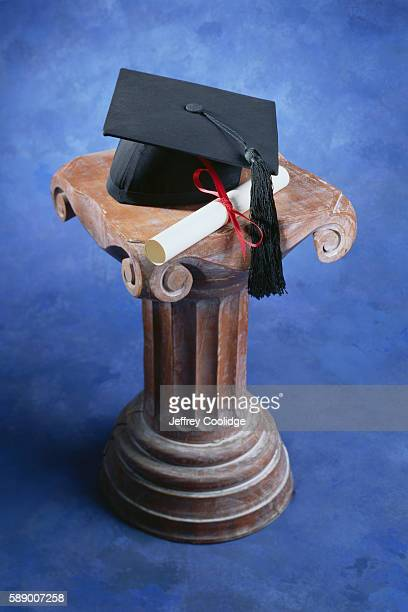 Mortarboard and Diploma on a Pedestal