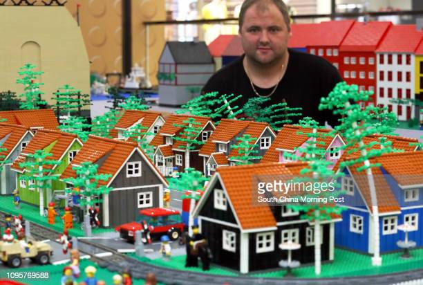 Morten Anker Skov decorates the LEGO town at the media preview at Denmark Dynamic Bricks LEGO Exhibition showing Lego built by Denmarks LEGO...