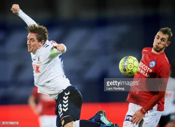 Morten Duncan Rasmussen of AGF Aarhus and Jens Martin Gammelby of Silkeborg IF compete for the ball during the Danish Alka Superliga match between...