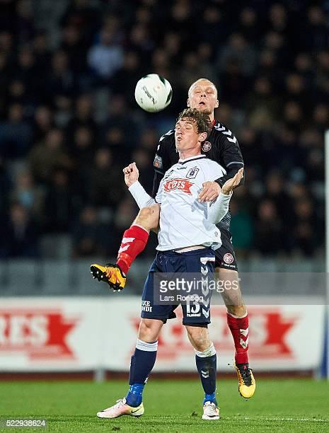 Morten Duncan Rasmussen of AGF Aarhus and Kasper Pedersen of AaB Aalborg compete for the ball during the Danish Cup DBU Pokalen semifinal match...