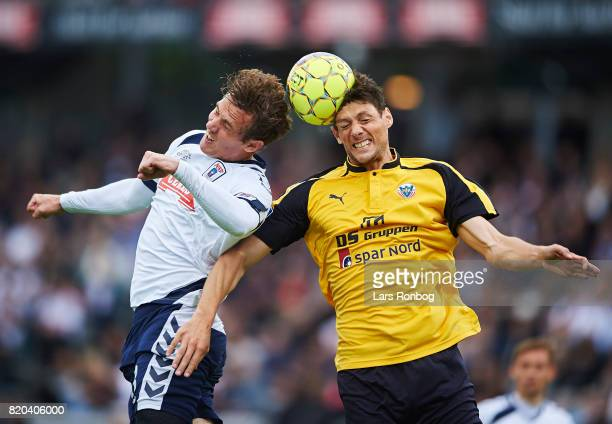 Morten Duncan Rasmussen of AGF Aarhus and Rasmus Minor Petersen of Hobro IK compete for the ball during the Danish Alka Superliga match between AGF...