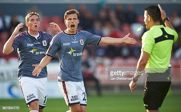 Morten Duncan Rasmussen of AGF Arhus Elmar Bjarnason of AGF Arhus and referee Sandi Putros in discussion during the Danish Alka Superliga match...