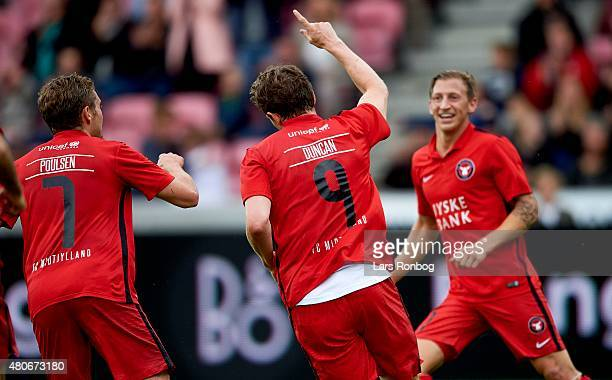 Morten Duncan Rasmussen of Midjylland celebrates after scoring their first goal during in the UEFA Champions League 2nd round 1st Leg match between...