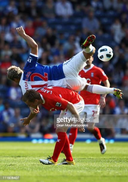 Morten Gamst Pedersen of Blackburn climbs over Sebastian Larsson of Birmingham City for the header during the Barclays Premier League match between...