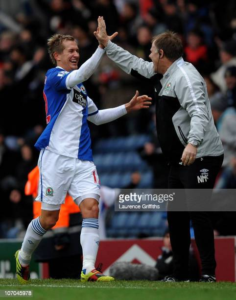 Morten Gamst Pedersen of Blackburn Rovers celebrates scoring the opening goal with Blackburn Rovers Assistant Manager Neil McDonald during the...