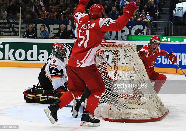 Morten Madsen of Denmark celebrates after scoring his team's opening goal during the IIHF World Championship group A match between Denmark and...
