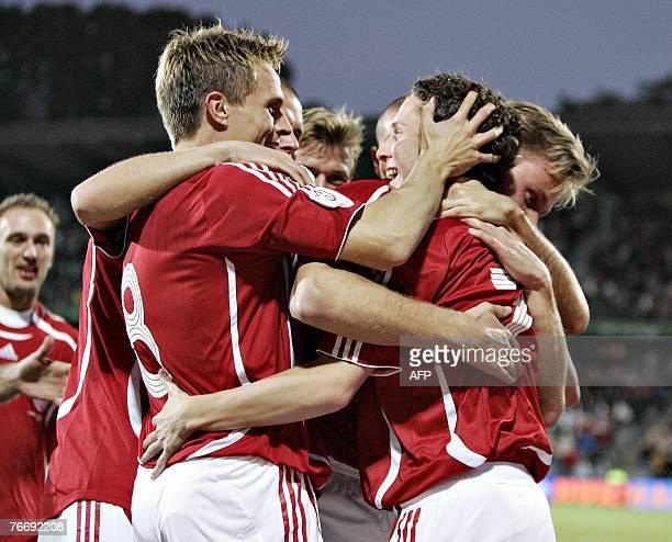 Morten Nordstrand celebrates with teammates after scoring against Liechtenstein during their Euro 2008 group F qualifying match at NRGI Stadium in...