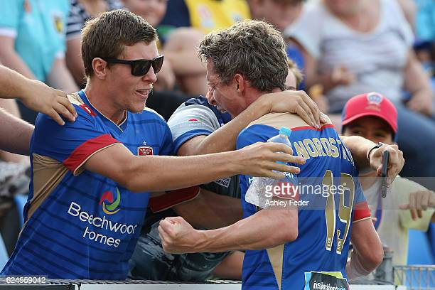 Morten Nordstrand of the Jets celebrates with supporters during the round seven ALeague match between the Newcastle Jets and the Central Coast...