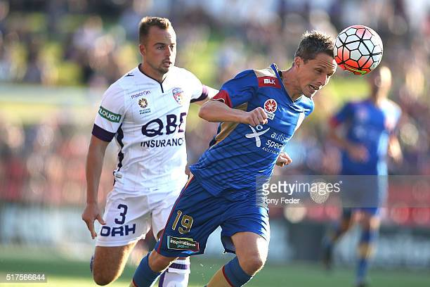 Morten Nordstrand of the Jets heads the ball in front of Marc Warren of the Glory during the round 25 ALeague match between the Newcastle Jets and...