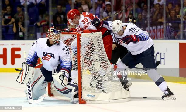 Morten Poulsen of Denmark challenges Brady Skjei of United States during the 2019 IIHF Ice Hockey World Championship Slovakia group A game between...
