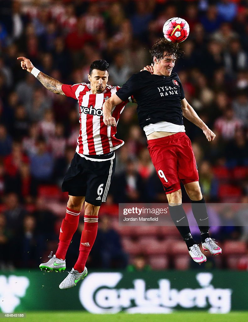 Morten Rasmussen of Midtjylland wins a header from Jose Fonte of Southampton during the UEFA Europa League Play Off Round 1st Leg match between Southampton and Midtjylland at St Mary's Stadium on August 20, 2015 in Southampton, England.