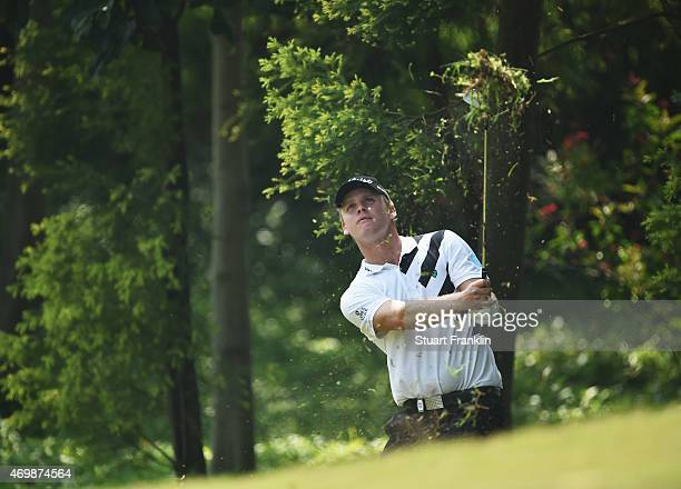 Morten Ørum Madsen of Denmark plays a shot during the first round of the Shenzhen International at Genzon Golf Club on April 16 2015 in Shenzhen China