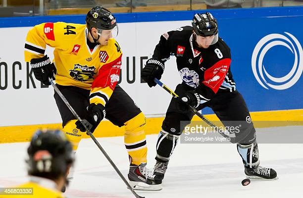 Morten Skov of Sonderjyske and Nicolas St. Pierre of Krefeld Pinguine in the 2nd period during the Champions Hockey League group stage game between...