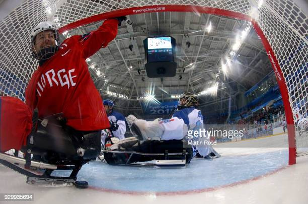 Morten Vaernes of Norway celebrates after he scores the equalizing goal in the Ice Hockey Preliminary Round Group A game between Norway and Italy...