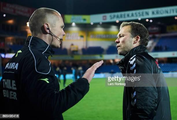 Morten Wieghorst head coach of AaB Aalborg shows frustration against 4th referee Henrik Overgaard after the Danish Alka Superliga match between...