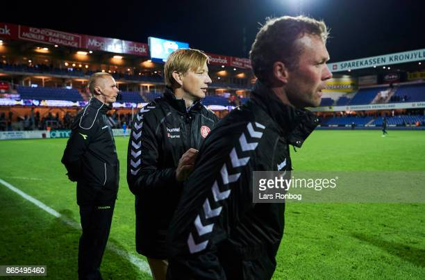 Morten Wieghorst head coach of AaB Aalborg shows frustration against 4th referee Henrik Overgaard and are being held away of Allan Gaarde sports...