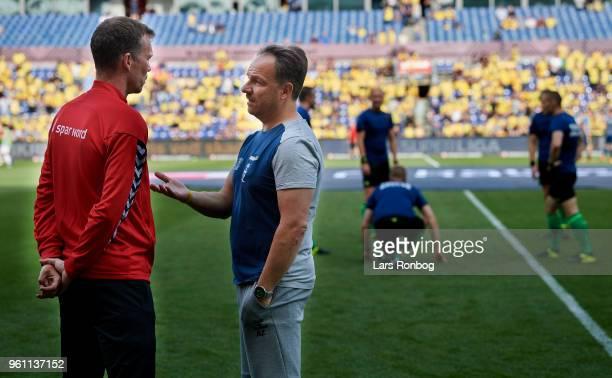 Morten Wieghorst head coach of AaB Aalborg speaks to Alexander Zorniger head coach of Brondby IF prior to the Danish Alka Superliga match between...