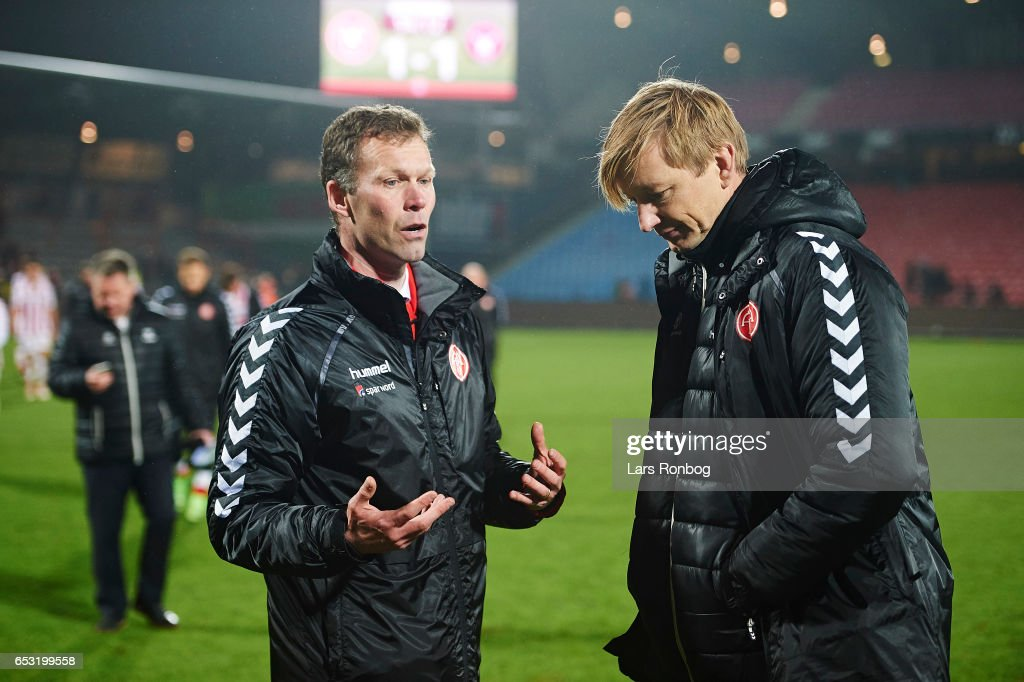 Morten Wieghorst, head coach of AaB Aalborg speaks to Allan Gaarde, sports director of AaB Aalborg after the Danish Alka Superliga match between AaB Aalborg and FC Midtjylland at Aalborg Portland Park on March 13, 2017 in Aalborg, Denmark.