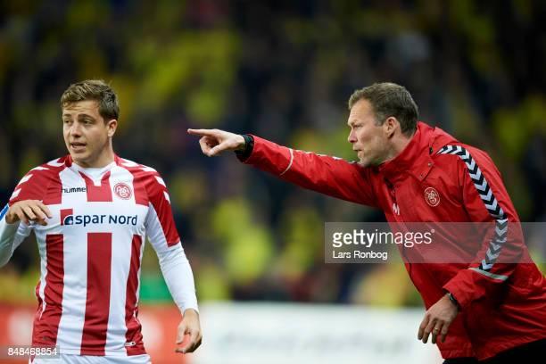 Morten Wieghorst head coach of AaB Aalborg speaks to Frederik Borsting of AaB Aalborg during the Danish Alka Superliga match between Brondby IF and...