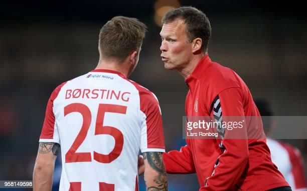 Morten Wieghorst head coach of AaB Aalborg speaks to Frederik Borsting of AaB Aalborg during the Danish Alka Superliga match between AaB Aalborg and...