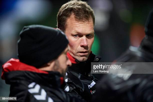 Morten Wieghorst head coach of AaB Aalborg speaks to Jacob Friis assistant coach of AaB Aalborg during the Danish Alka Superliga match between Lyngby...
