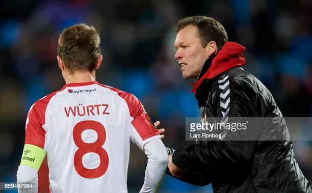 Morten Wieghorst head coach of AaB Aalborg speaks to Rasmus Wurtz of AaB Aalborg during the Danish Alka Superliga match between AaB Aalborg and FC...