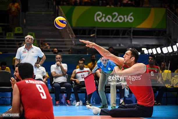 Morteza Mehrzadselakjani of Iran competes during Mens Sitting Volleyball match between Iran and Ukraine on day 7 of the Rio 2016 Paralympic Games at...