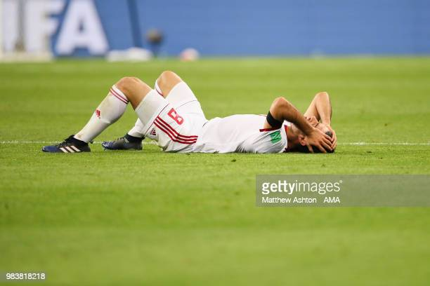 Morteza Pouraliganji of IR Iran lies dejectedly on the pitch at the end of the 2018 FIFA World Cup Russia group B match between Iran and Portugal at...