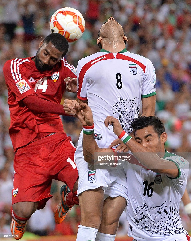 Morteza Pouraliganji of Iran and Mohamed Abdulrahman of the United Arab Emirates compete for the ball during the 2015 Asian Cup match between IR Iran and the UAE at Suncorp Stadium on January 19, 2015 in Brisbane, Australia.