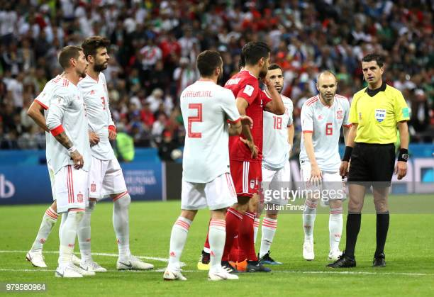 Morteza Pouraliganji of Iran argues with Referee Andres Cunha during the 2018 FIFA World Cup Russia group B match between Iran and Spain at Kazan...