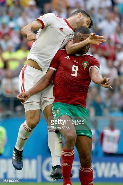 Morteza Pouraliganji of Iran clashes with Ayoub El kaabi of Morocco during the 2018 FIFA World Cup Russia group B match between Morocco and Iran at...