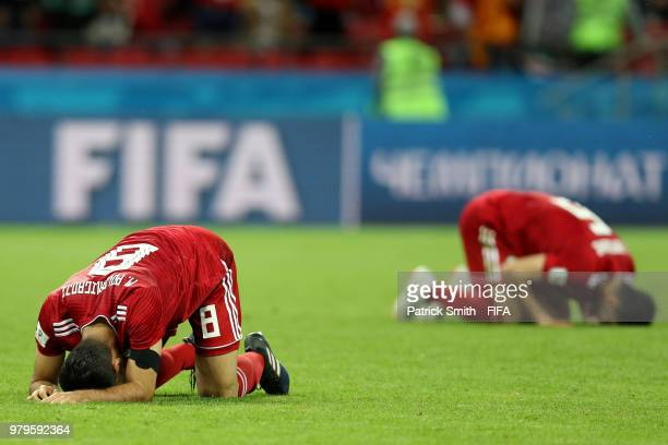 Morteza Pouraliganji of Iran looks dejected following his sides defeat in the 2018 FIFA World Cup Russia group B match between Iran and Spain at...