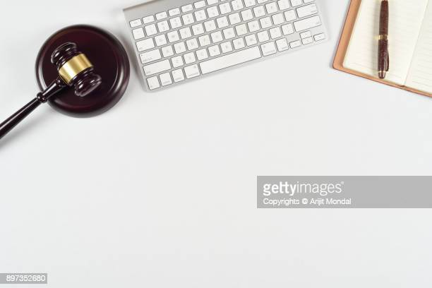 Mortgage advisory concept with Gavel, computer keyboard, document, top view flat lay