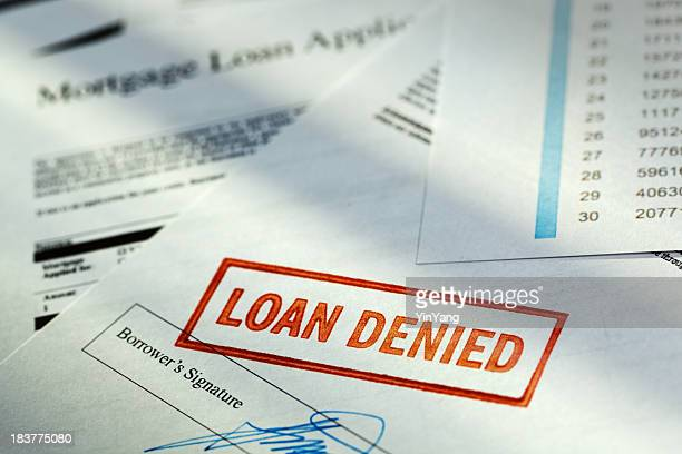 "mortgage application borrower document with ""loan denied"" red rubber stamp - dismissal stock photos and pictures"